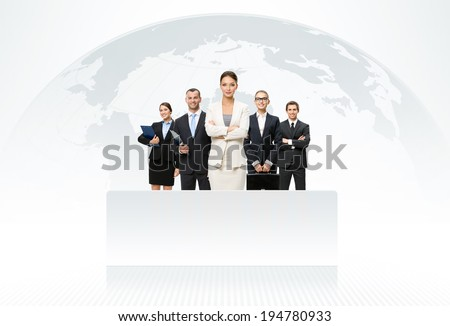 International business team with map of the world in background - stock photo