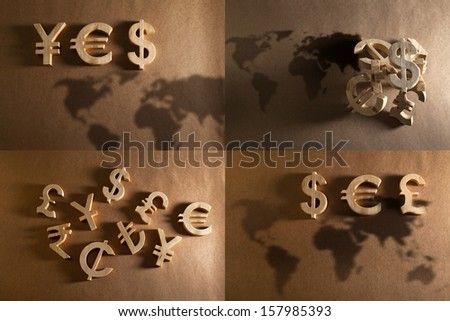 international currency unit collection by wood on recycled background - stock photo