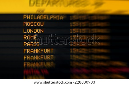 international departure board at an airport - stock photo