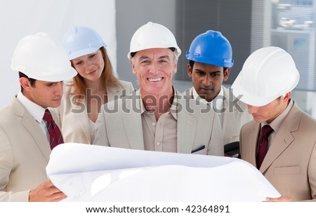 International engineer co-workers discussing a project in a building - stock photo