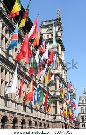International flags on City Hall of Antwerp, Belgium - stock photo
