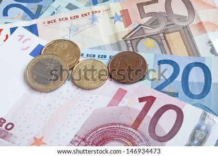 international money,financial concept,euro banknotes and coins  - stock photo