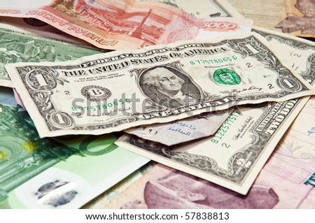International money, paper currency and one dollar over all - stock photo