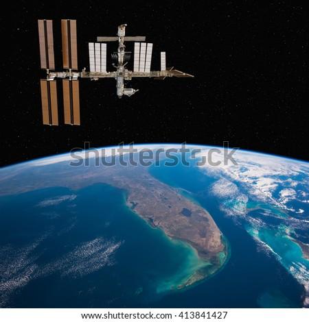 International Space Station over Florida. Elements of this image furnished by NASA. - stock photo