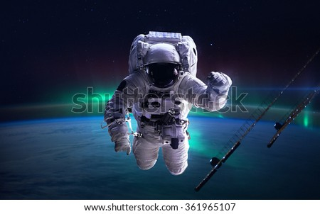 International Space Station with astronaut over the planet Earth. Elements of this image furnished by NASA - stock photo