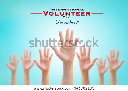 International Volunteer Day for Economic and Social Development conceptual idea: Many people blurred hands raising upward on vintage sky background showing vote, volunteering, participation concept  - stock photo