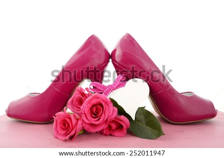 International Womens Day, March 8, ladies pink high heel stiletto shoes and roses on vintage pink wood background. - stock photo