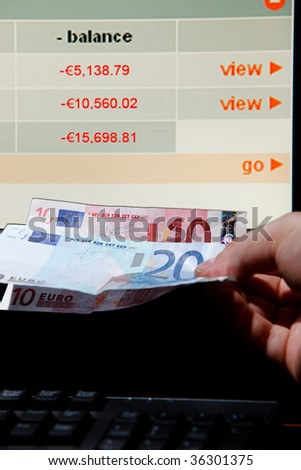 Internet Banking: Struggling with debt repayment. - stock photo