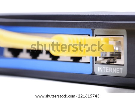 Internet connection socket. Closeup with shallow DOF. Isolated on white background. - stock photo