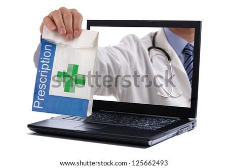 Internet drug store concept doctor holding prescription medicine through a laptop screen - stock photo