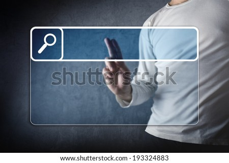 Internet search concept. Male hand pointing at empty search bar on virtual screen with copy space for your text. - stock photo