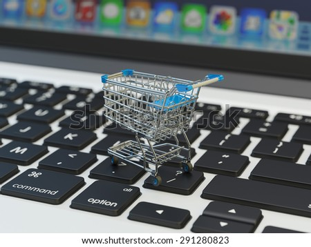 Internet shopping and online purchases concept, macro view of supermarket shopping cart on computer laptop keyboard background with applications icons - stock photo