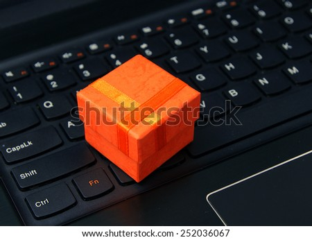 Internet shopping (e-shopping): Gift on the notebook keyboard - stock photo