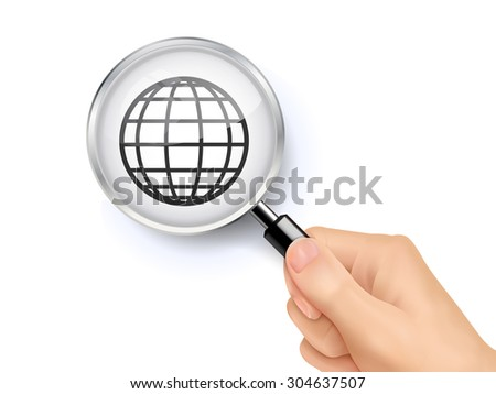 internet symbol showing through magnifying glass held by hand - stock photo