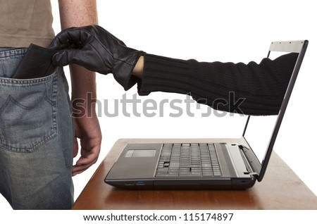 Internet theft - a gloved hand reaching through a laptop screen to steal a wallet from a man. - stock photo