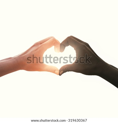 interracial couple in love heart shape hand gesture - stock photo