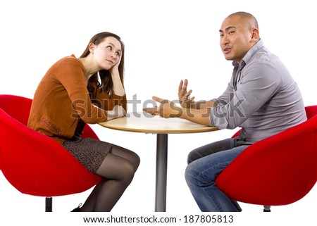Interracial date that is boring and un-romantic - stock photo