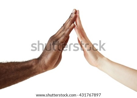 Interracial friendship and cooperation concept. Two people od different ethnicities holding hands in unity, respect and understanding. Peace and unity against racism. White female and black man hands - stock photo