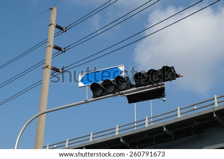 Intersection light and banner - stock photo