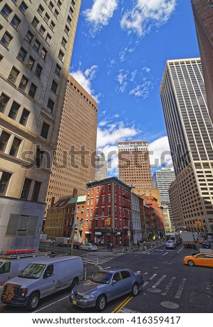 Intersection of Water Street and Broad Street in Financial District in Lower Manhattan, New York City, USA. - stock photo
