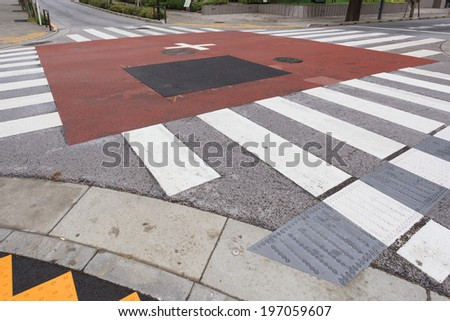Intersection with crosswalk, Tokyo, Japan - stock photo