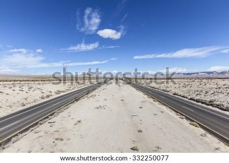 Interstate 15 between Los Angeles and Las Vegas in California's Mojave Desert. - stock photo