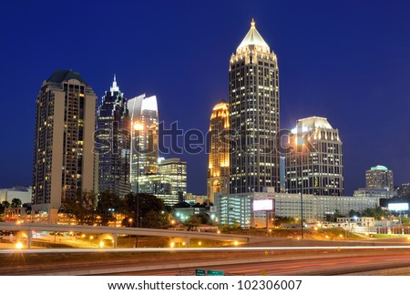 Interstate 85 runs below the skyline of Midtown Atlanta, Georgia, USA. - stock photo