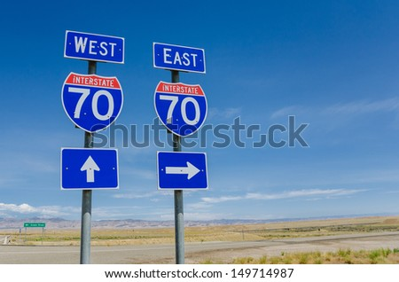 Interstate Signs Against Blue Sky - stock photo