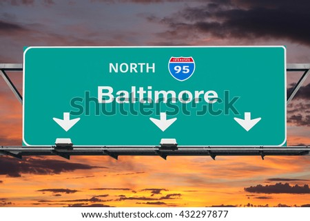 Interstate 95 to Baltimore Highway Sign with Sunrise Sky - stock photo