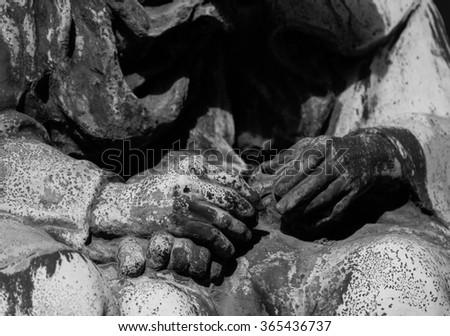 intertwined hands (tombstones statue) - stock photo