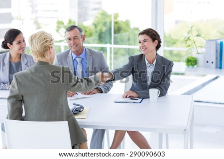 Interview panel listening to applicant in the office - stock photo