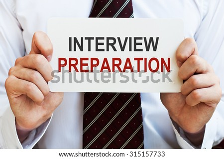 Interview Preparation card in male hands - stock photo