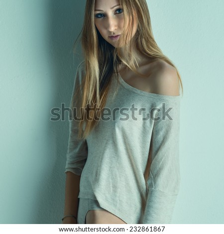 Intimate woman portrait against wall background. Filtered image instagram style. - stock photo