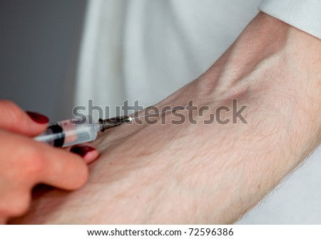 Intravenous injection by medical doctor to patient separately on the grey background - stock photo