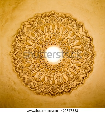 Intricate Islamic carvings on the ceiling - stock photo