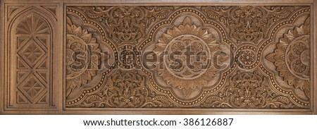 Intricate islamic wood crafted design. Islamic design carved on wooden panel. - stock photo