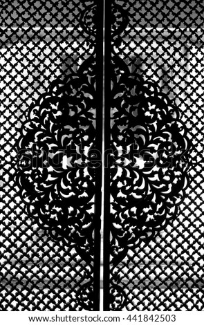 Intricate pattern on the doors of Paigah tombs - stock photo