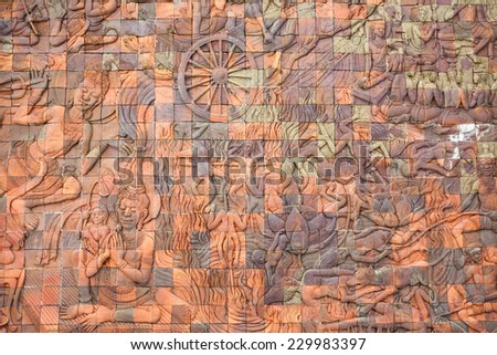 Intricate Thai carving mural - stock photo