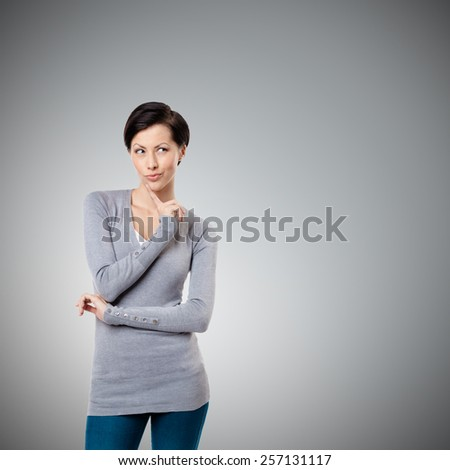 Intriguing look, isolated on grey background - stock photo