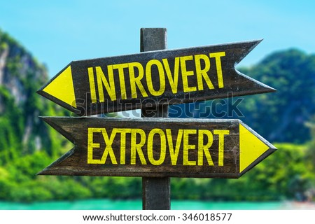 Introvert - Extrovert signpost in a beach background - stock photo
