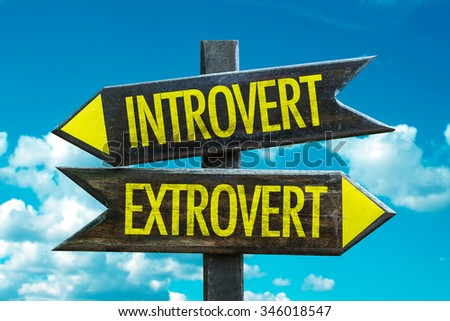 Introvert - Extrovert signpost with sky background - stock photo