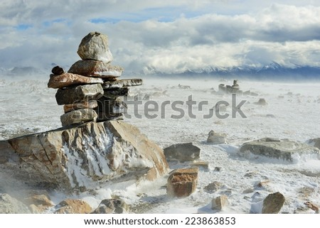 Inukshuk on Mountain Summit - stock photo