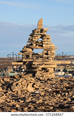 Inuksuk marker in Igloolik - stock photo