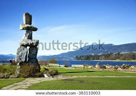 Inukuk at English Bay in Vancouver.  An inuksuk is a human-made stone landmark. - stock photo