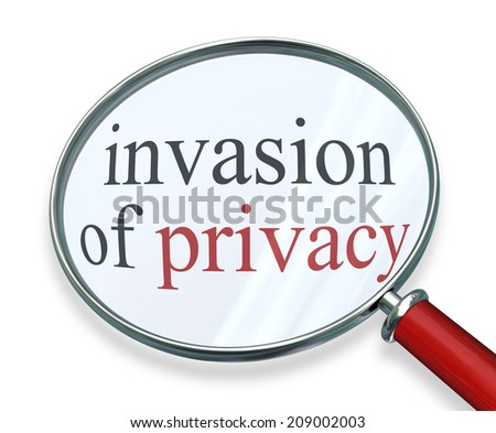 Invasion of Privacy words under a 3d magnifying glass as sensitive information is stolen, leaked or hacked in online theft  - stock photo