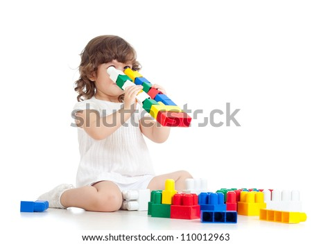 inventive kid with construction set toy over white background - stock photo