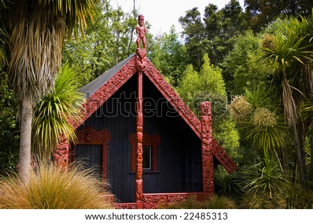 INVERCARGILL - Dec 27, 2008. Traditional carved meeting houses are a central part of the New Zealand Maori culture, as seen here at Anderson Park in Invercargill on Dec 27, 2008. - stock photo