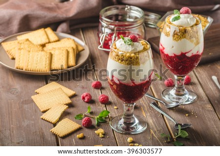 Inverted cheesecake dessert in glass, delicious and simple with fresh fruits and biscuit with light creame. - stock photo