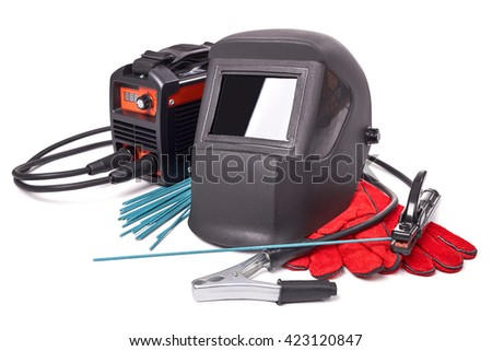 Inverter welding machine, welding equipment, isolated on a white background, welding mask, leather gloves, welding electrodes, high-voltage wires with clips, set of accessories for arc welding. - stock photo