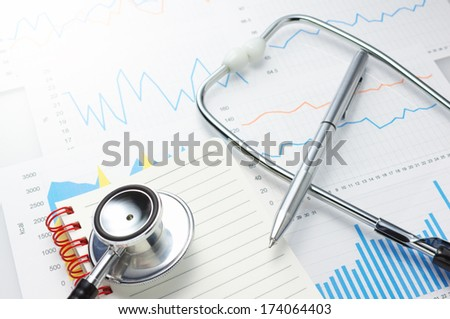 Investigation of daily health conditions. Close up of graphs, stethoscope, notebook and pen.  - stock photo